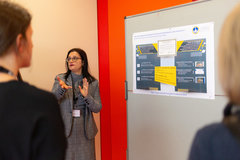 Participants in discussion during the poster session on the second day of the INCONECSS